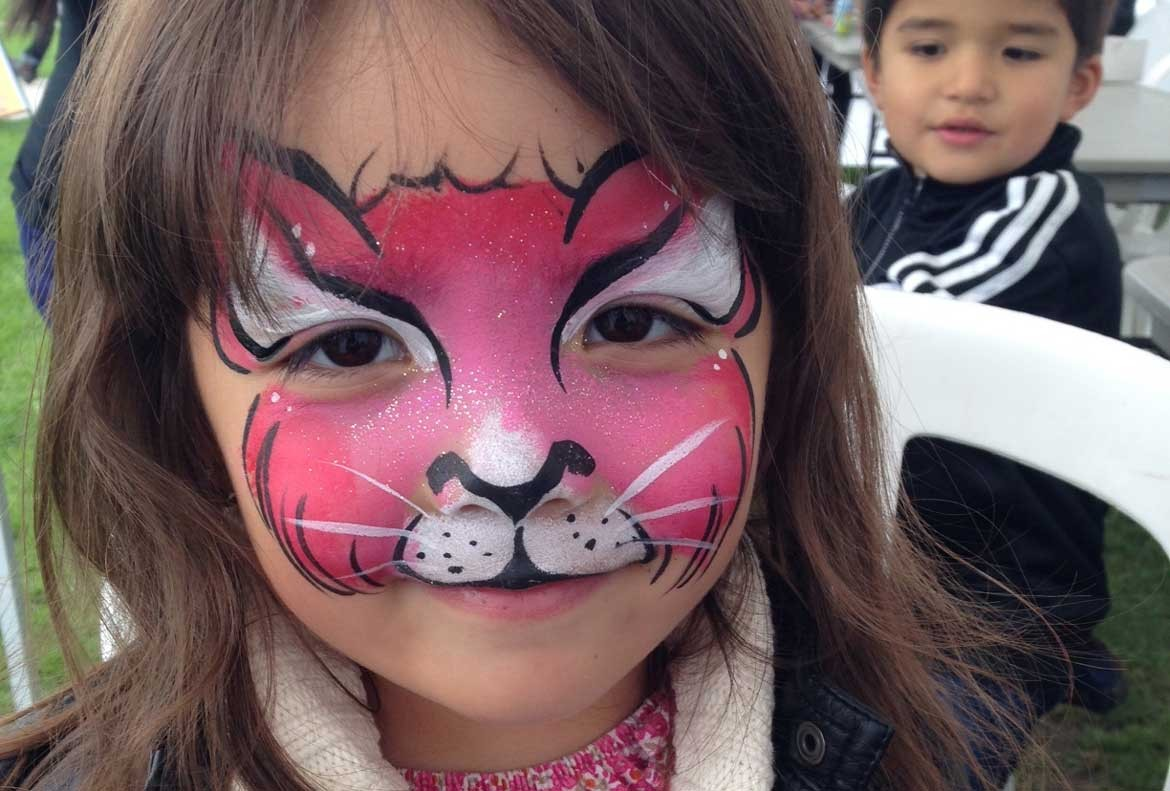 Pink Tiger painted on a young girl's face