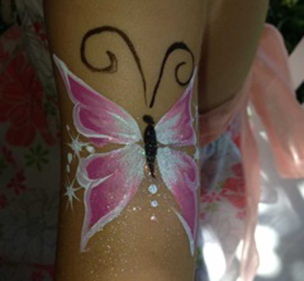 Body art butterfly on child's arm