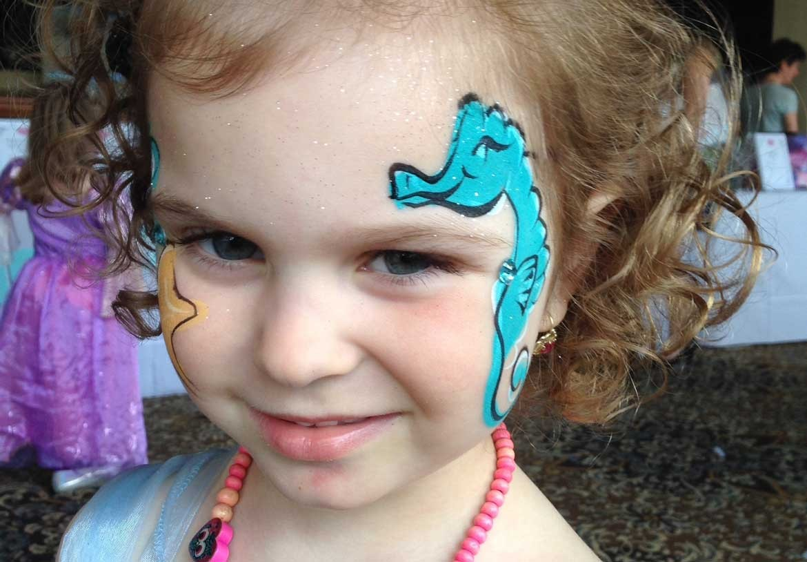 Under the sea themed face painting sea horse