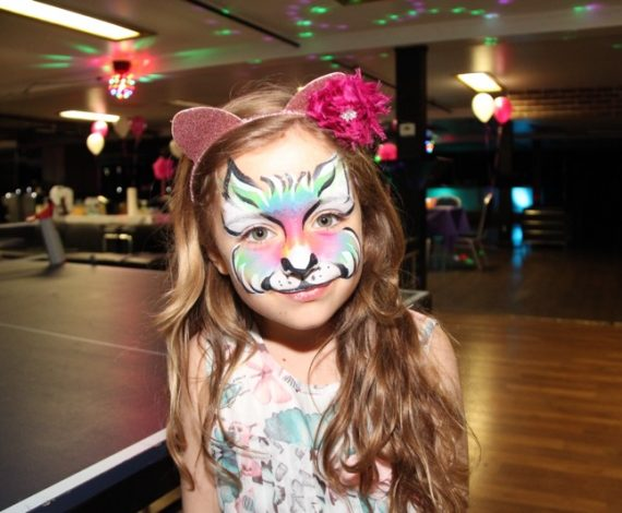 Colourful tiger painted on child's face