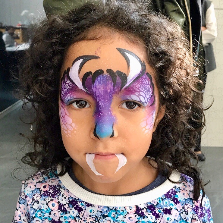 Purple Monster painted on child's face