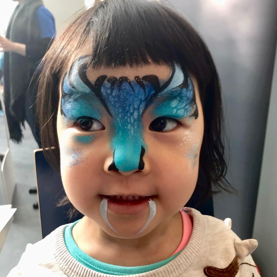 Blue Monster painted on child's face