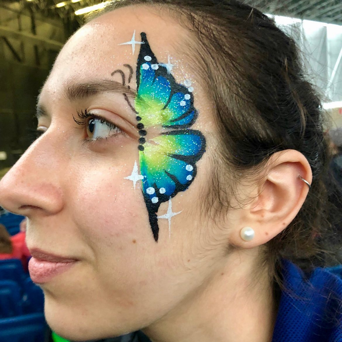 Beautiful blue and green butterfly adult's face painting