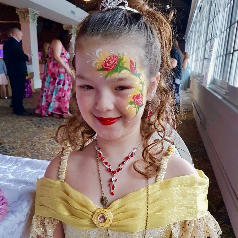 Beauty and The Beast themed Rose painted on child's face