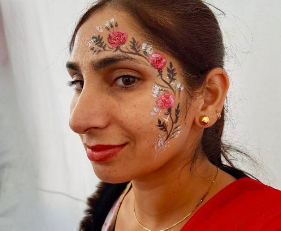 Beautiful flower pattern painted on adult woman's face