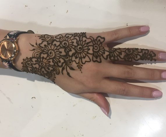 Beautiful henna on manicured hand.