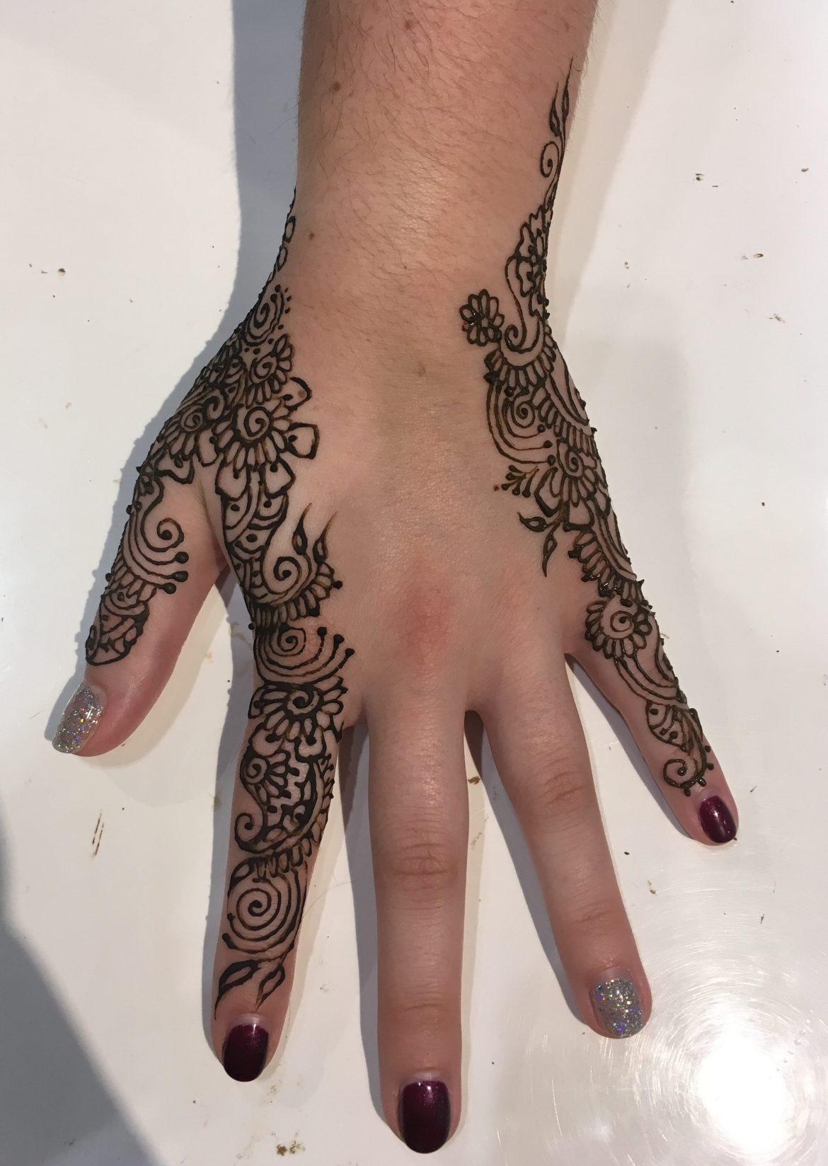 Beautiful henna on manicured hand.