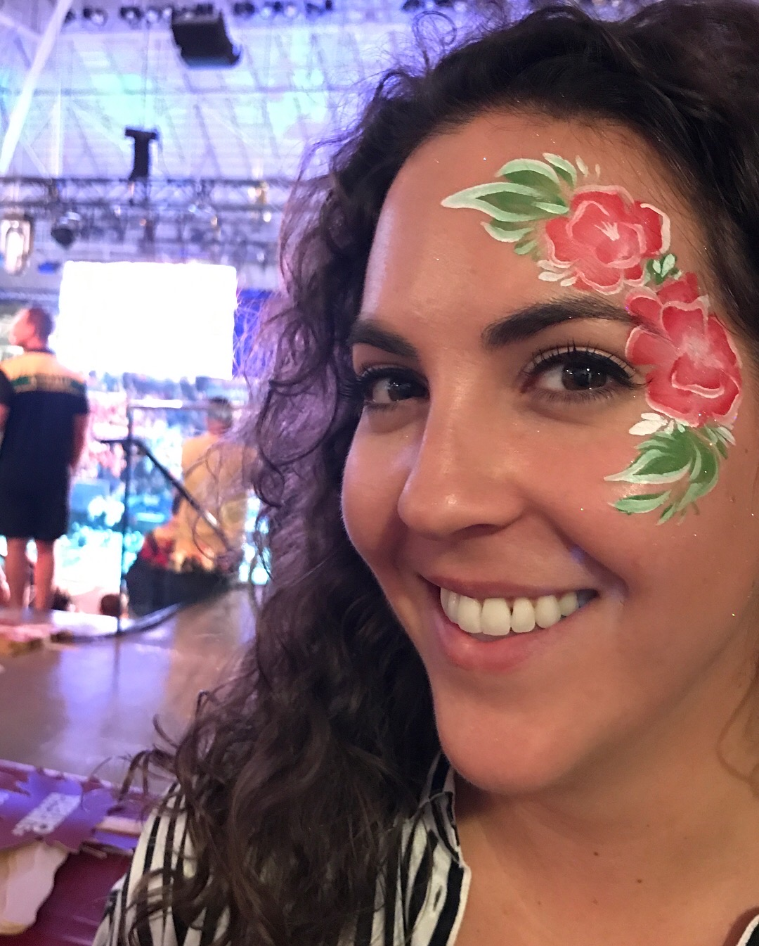 Pink flowers painted on woman's face