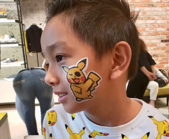 Pokemon Pikachu drawn on child's whole face