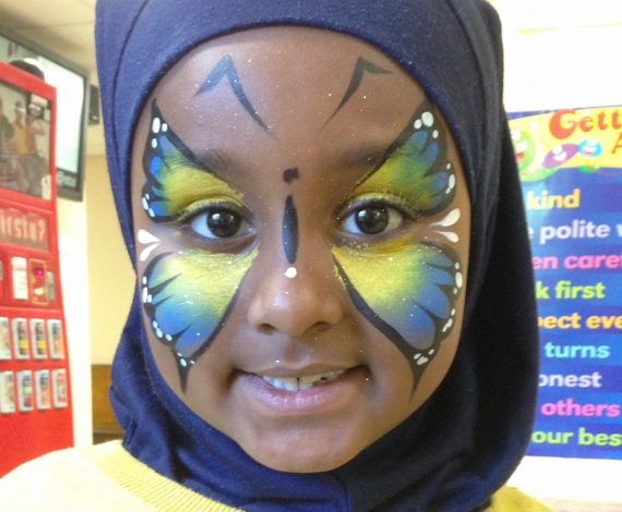 Lovely butterfly painted across a child's full face