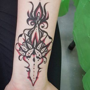 Beautiful body art design painted on a woman's forearm