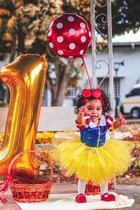 Baby dressed up as snow white on her first birthday