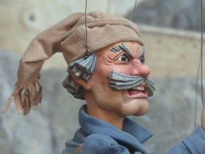 Puppet with moustache gives an angry face